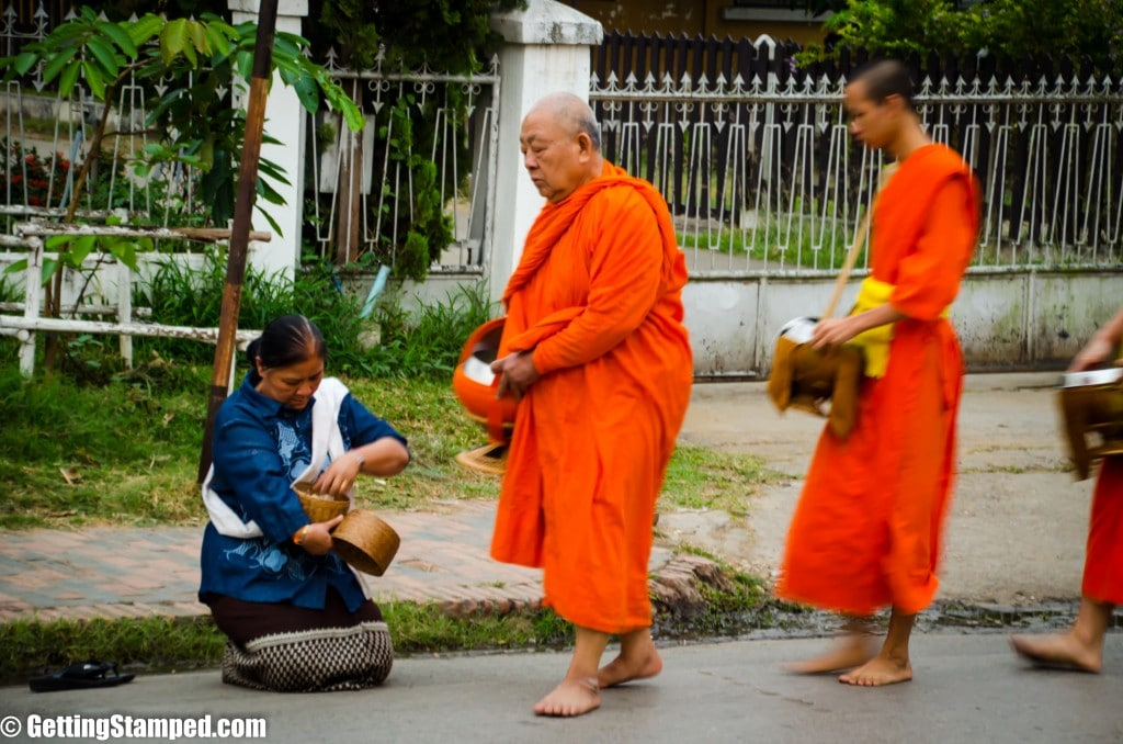 Theravada monks performing alms rounds.